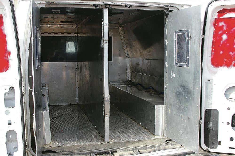 Ex-inmate left in hot NM prison van recovers $2M